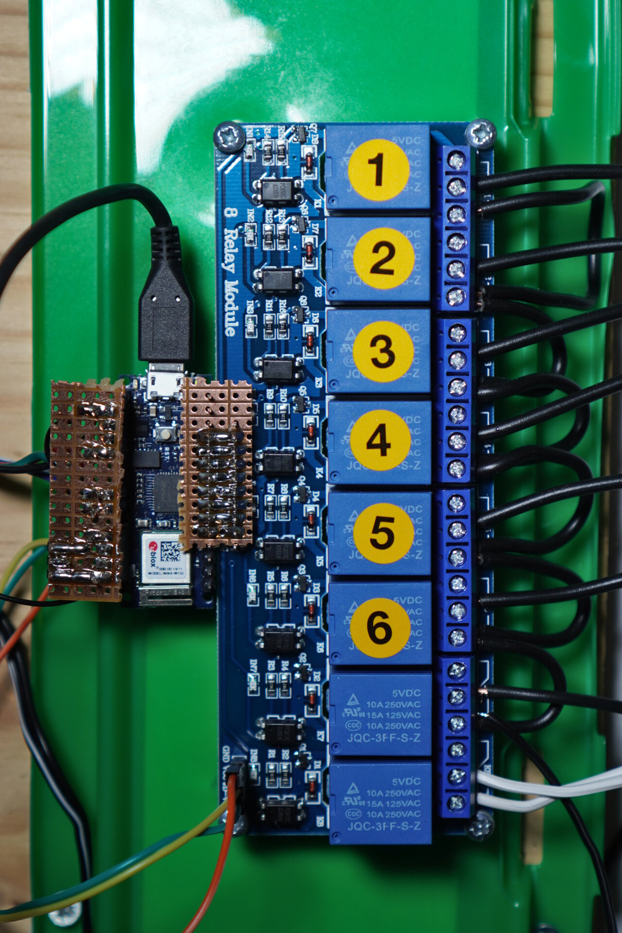 Photo of the Arduino soldered to a relay board.