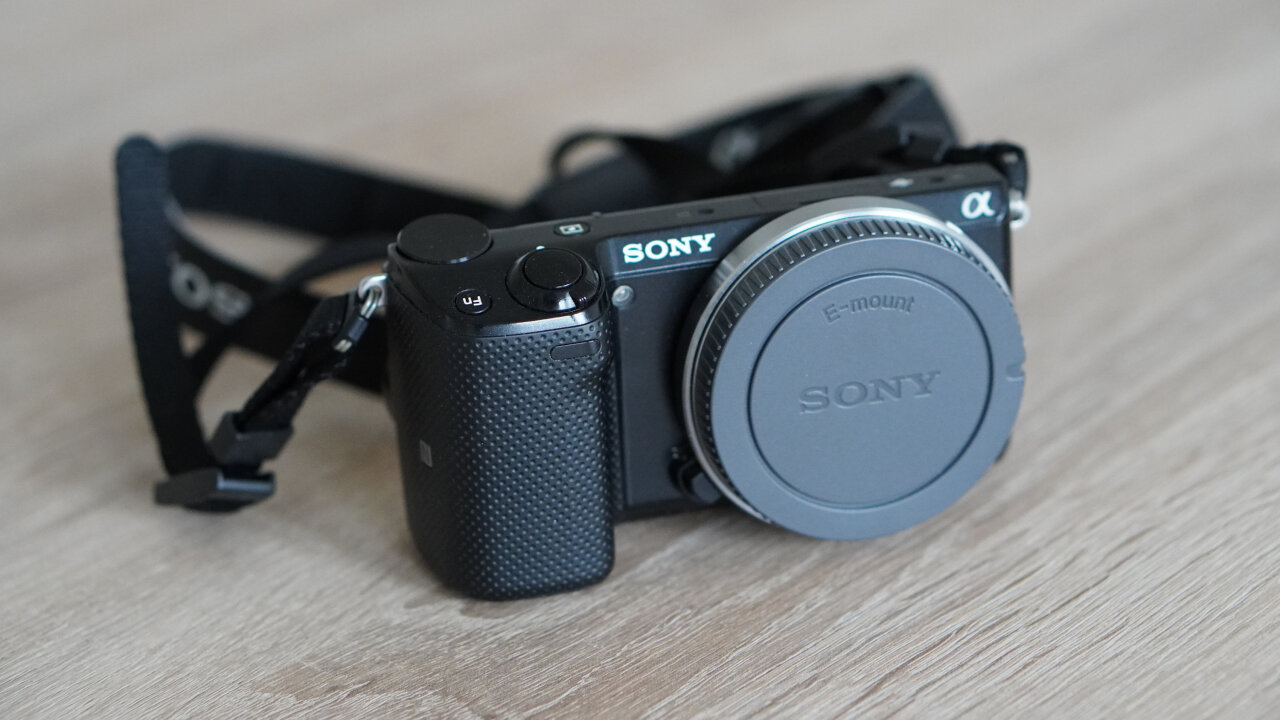 Photo of a Sony Alpha NEX-5T without a lens.