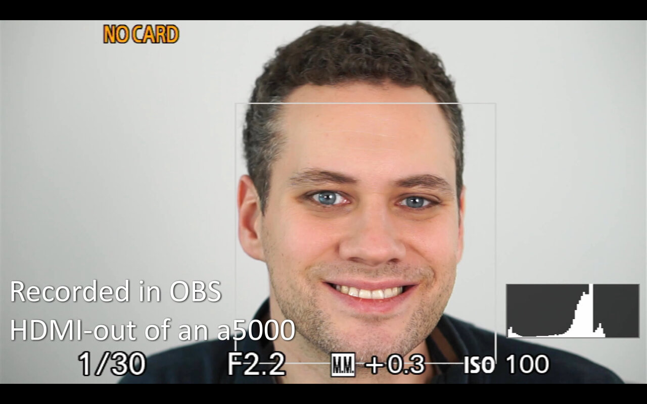 Recording from the a5000 showing an image of me looking into the camera. The image is clear, but there still is a user interface.